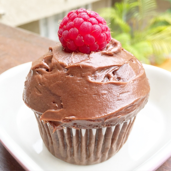 Triple Chocolate Fudge cupcake with raspberry whipped cream filling