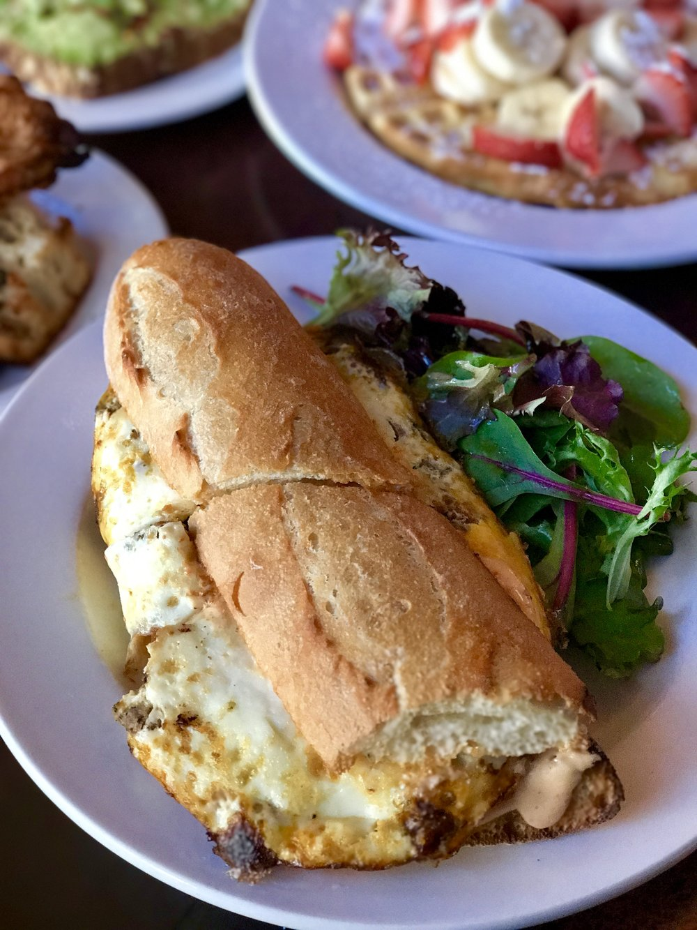 Baked eggs sandwich with merguez sausages, parmesan cheese, chipotle mayo on French baguette.