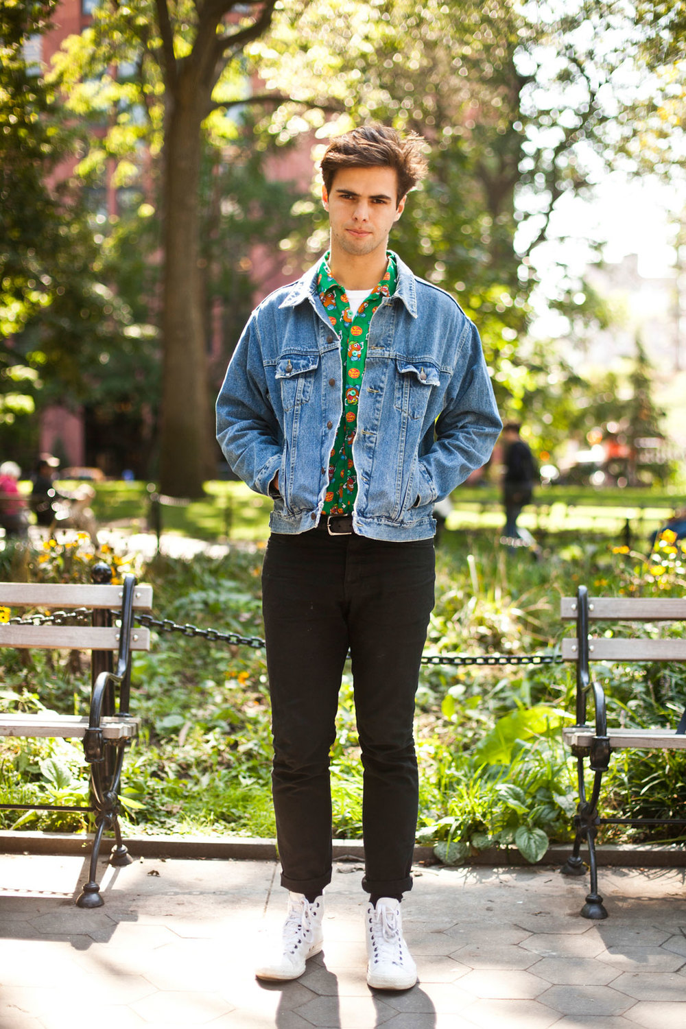 William Kammler from NYU Vintage shirt and jacket, Saturdays Surf NYC pants, and Converse sneakers.