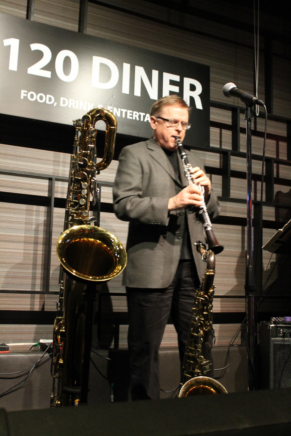 John MacMurchy with Jim Galloway's baritone saxophone in front of him at the 120 Diner in Toronto - Mar. 2016