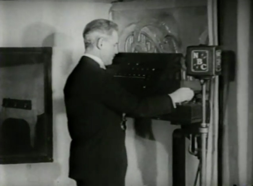 NBC staff announcer strikes the NBC Chimes in 1933
