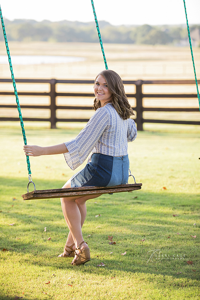 DFW Senior photographer, senior on swing, senior pose