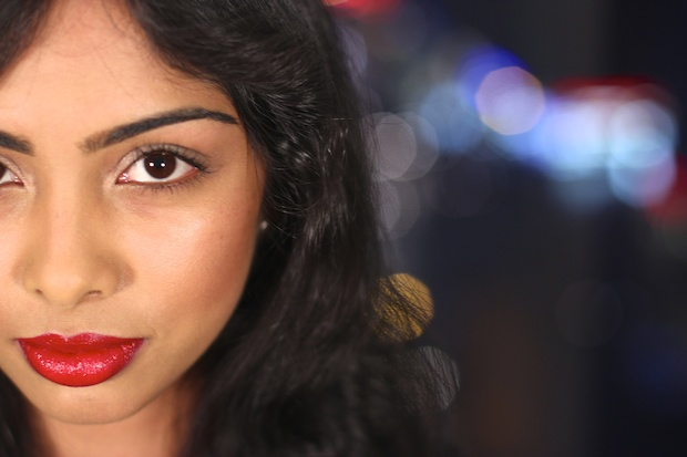 Nikhita has on Chanel Pirate lipstick.  Cream foundation by RCMA, NARS Deep Throat Blush, Hourglass Ambient Lighting Powder in Luminous Light, Chantecaille The Evening Duo eyeshadow, Kevyn Aucoin eyeshadow in Frosted Jade, Diorshow waterproof black mascara.