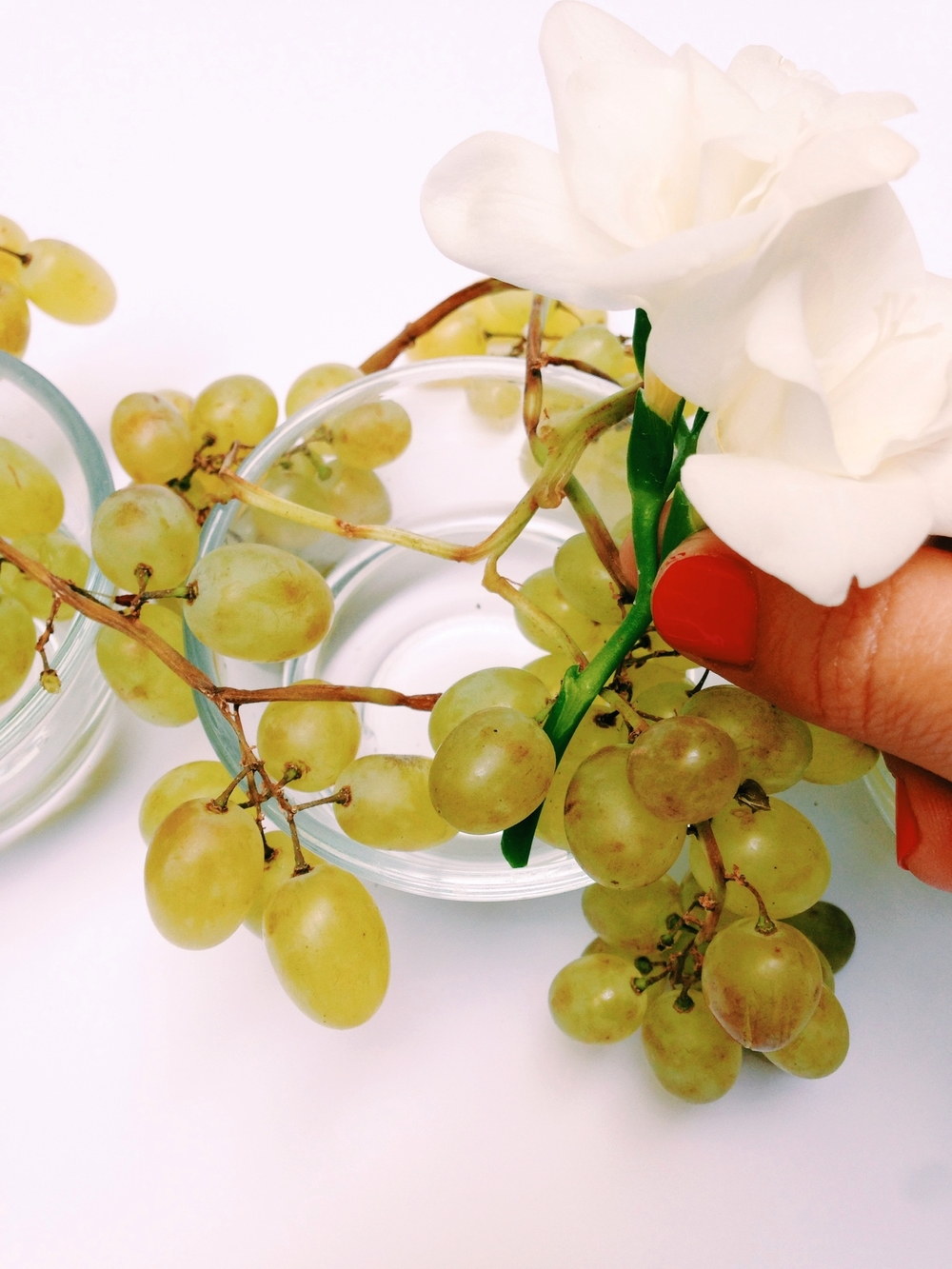 place the main white flowers into the grapes, making sure they stay in place where you want them