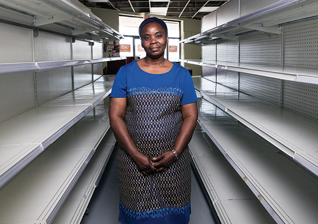 After the fire, Funmi Baiyewun, owner of all nations supermarket, had to throw out $172,000 worth of inventory. Photograph Curtis Trent