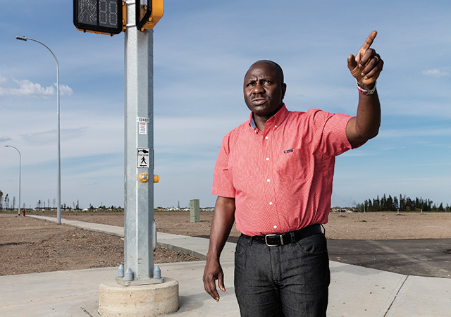 Kunle Oladebo, the pastor of Daystar Chapel, at Abraham's land, the future site of his new church. Photograph Curtis Trent