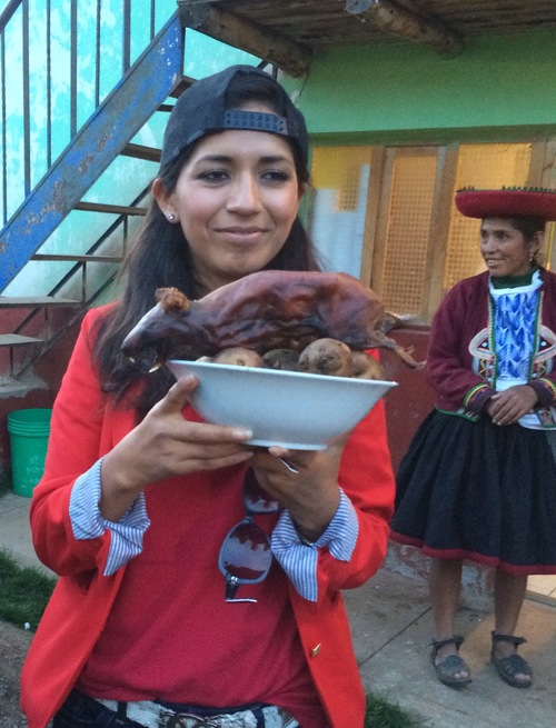 eating Cuy guinea pig in Peru with Contiki
