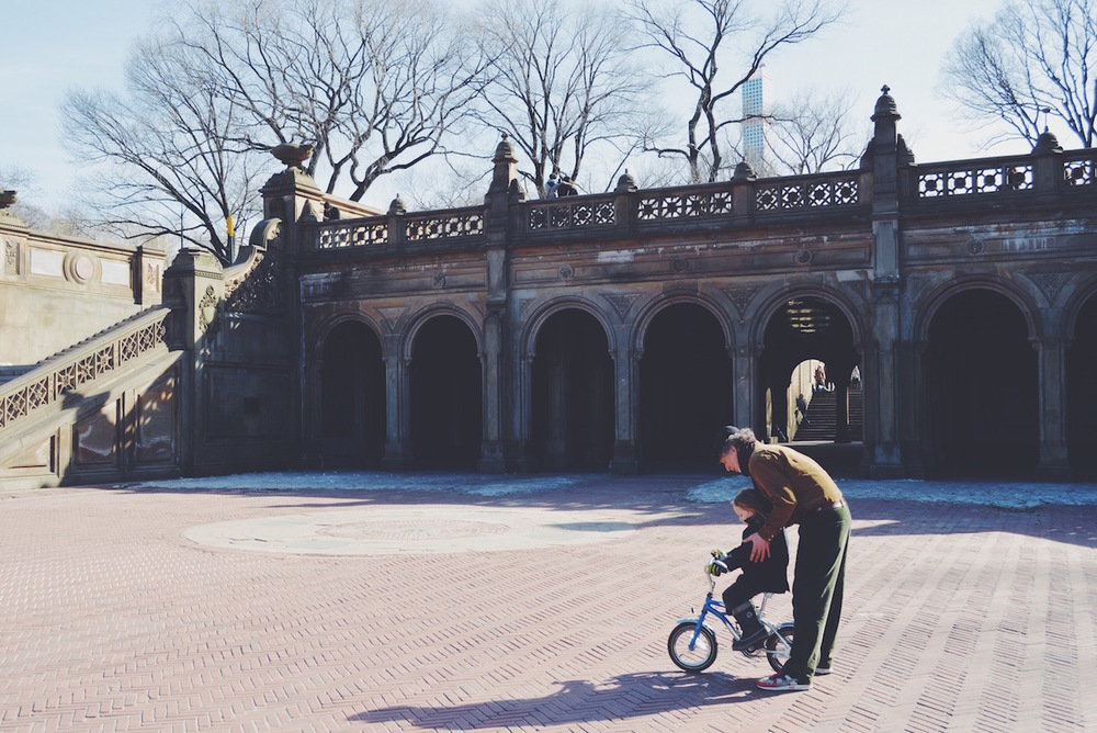 SPECIAL MOMENT IN CENTRAL PARK NEW YORK GRANDFATHER AND GRANDSON RIDING BIKE