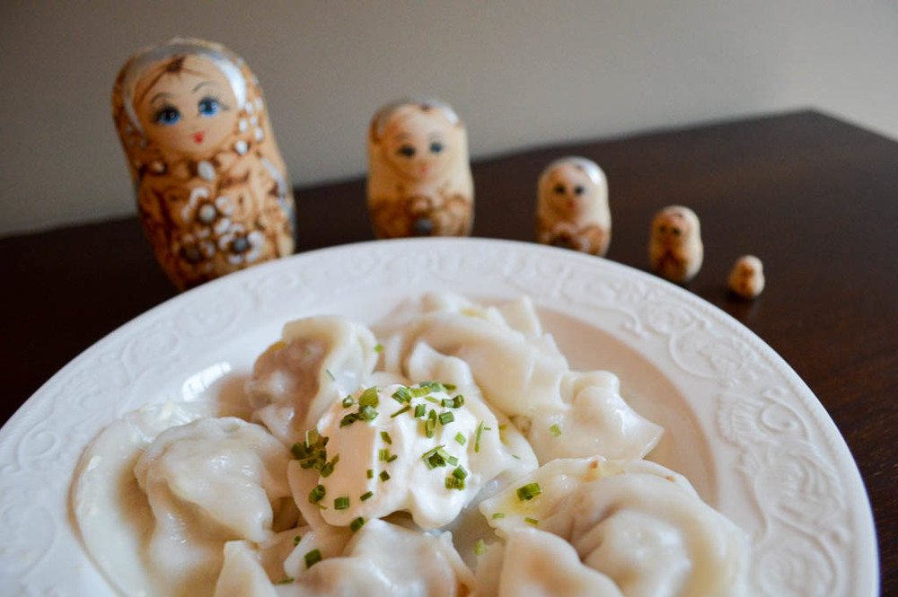 Russian Pelmeni with sour cream and Russian Dolls