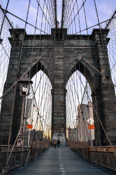 Walk across the Brooklyn Bridge into Manhatten