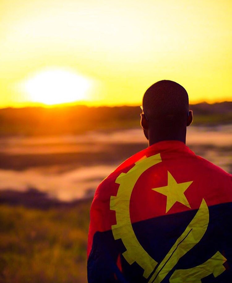 the angolan flag and my friend  ulika . His friend and talented photographer  notflavio  took this picture. NOTFLAVIO IS ALSO THE CURATOR OF  VIEWS OF ANGOLA , A FANTASTIC INSTAGRAM COLLECTION FROM ANGOLA