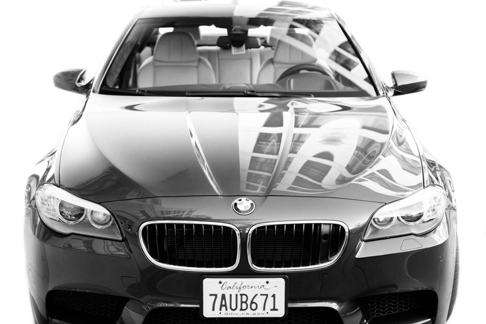 black and white of a BMW from the front