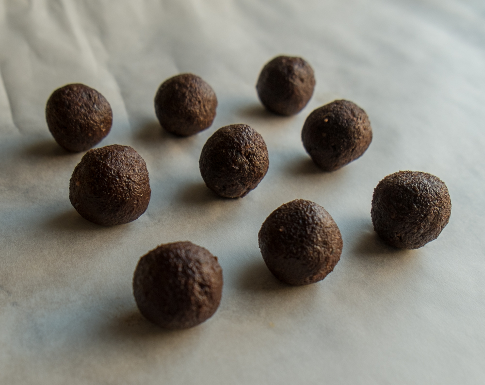 Chocolate orange truffles on paper