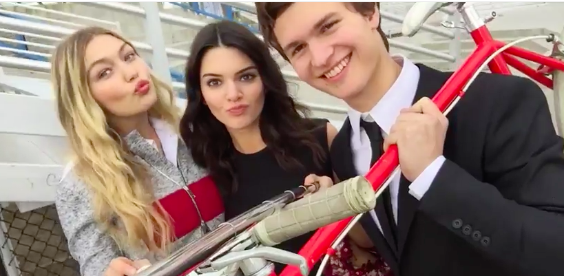 Gigi Hadid, Kendall Jenner, and Ansel Elgort having fun with their Selfie On A Stick for VOGUE Magazine shot by Mario Testino