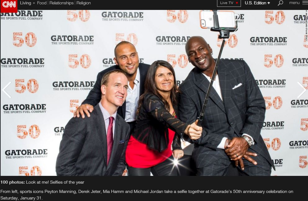 Eli Manning, Derek Jeter, Mia Hamm, and Michael Jordan pose for an ussie with a selfie stick.