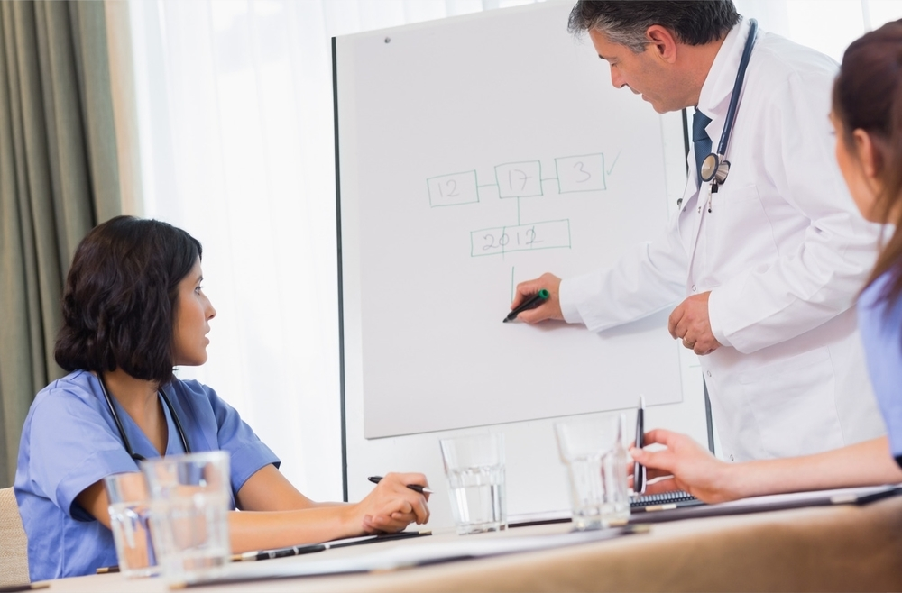 photodune-8443003-doctor-writing-on-presentation-board-during-meeting-with-nurses-l.jpg