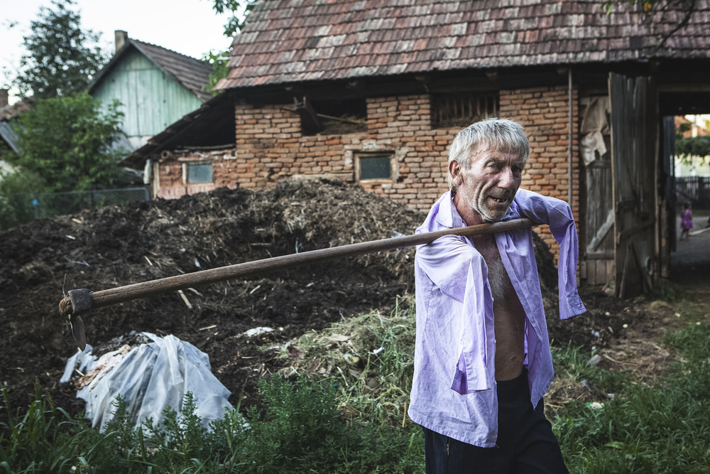 Istv�n Szuh�nyi outside his home in Transylvania.