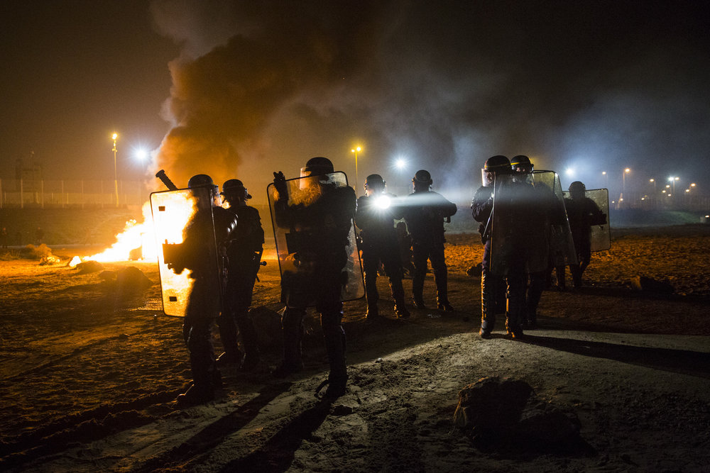 FRANCE, Calais: French riot police advance towards the Jungle migrant and refugee camp during a clash.