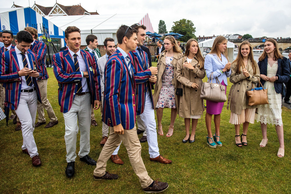 Spectators gather along the bank of the River Thames at the Henley Royal Regatta on June 28, 2017 in Henley-on-Thames.