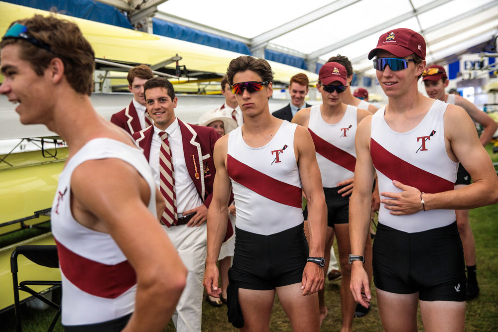A crew gather around the rowing boats following a race at the Henley Royal Regatta on June 28, 2017 in Henley-on-Thames.