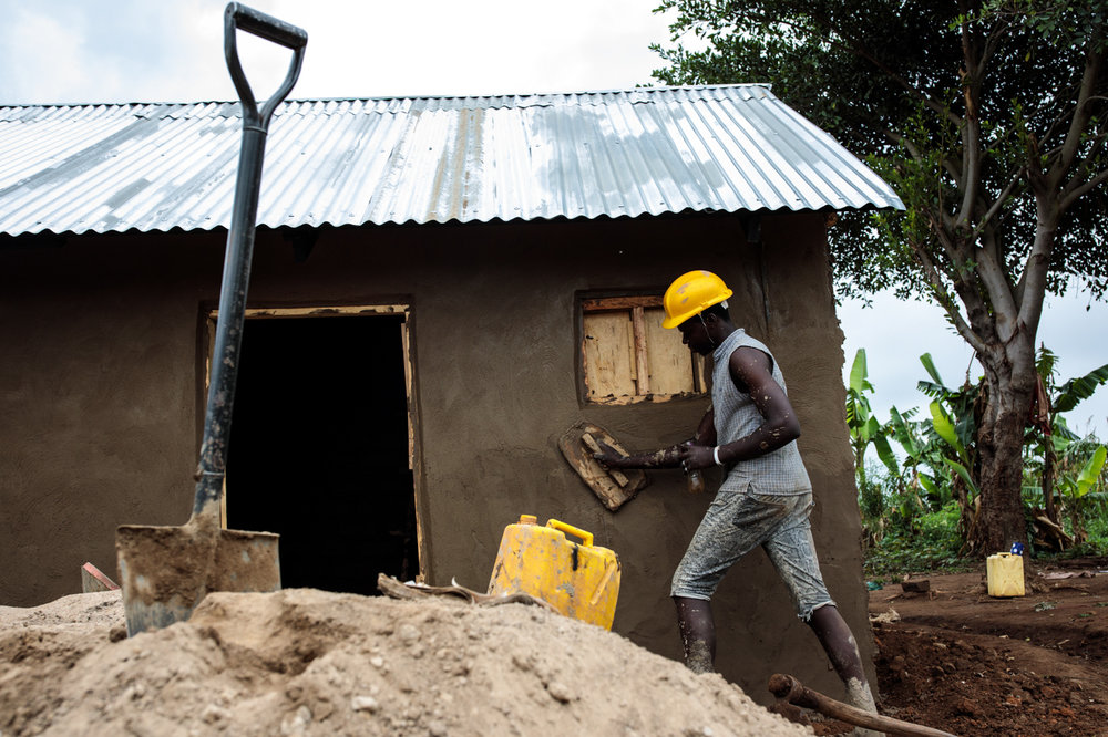KYANGWALI, UGANDA: A young refugee from the Democratic Republic of Congo helps build a shelter in the Kyangwali Refugee Settlement on April 3, 2018.