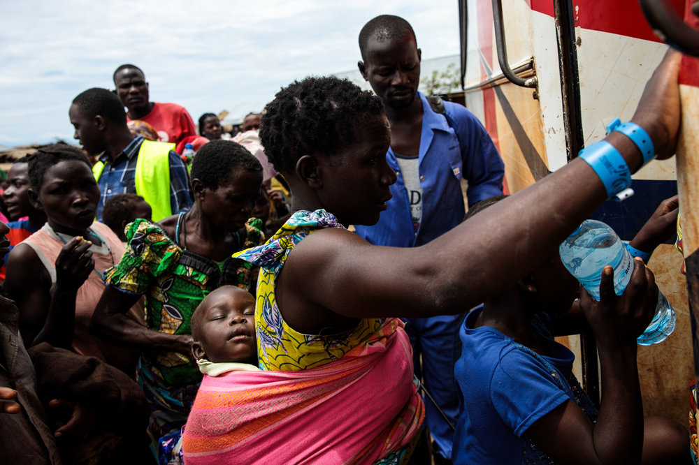 SEBAGORO, UGANDA: Refugees from the Democratic Republic of Congo make their way on to a bus for the Kagoma reception centre from the UNHCR landing site for refugee arrivals on April 4, 2018.