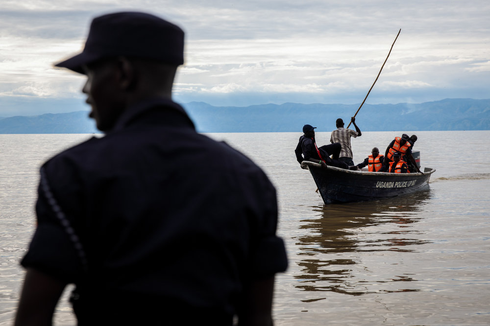 SEBAGORO, UGANDA: Ugandan Police respond to reports of a refugee from the Democratic Republic of Congo drowning during a crossing over Lake Albert by a UNHCR landing site on April 6, 2018.