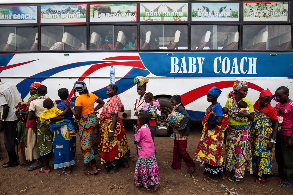 NSONGA, UGANDA: Refugees from the Democratic Republic of Congo board a bus from the Nsonga landing site to a reception centre on April 9, 2018.