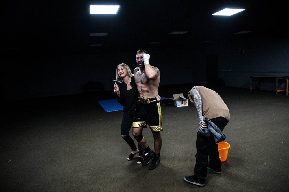 MANCHESTER, ENGLAND: Bare-Knuckle Boxier Luke Atkin, age 30 from York, is supported by his partner as he makes his way backstage after losing his Rogue Elite world title fight with Dom Clark during an Ultimate Bare Knuckle Boxing (UBKB) event at Bowlers Exhibition Centre on August 4, 2018.