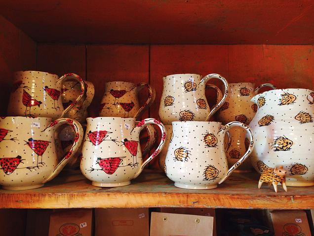 {handmade pottery decorated with chickens and porcupines}