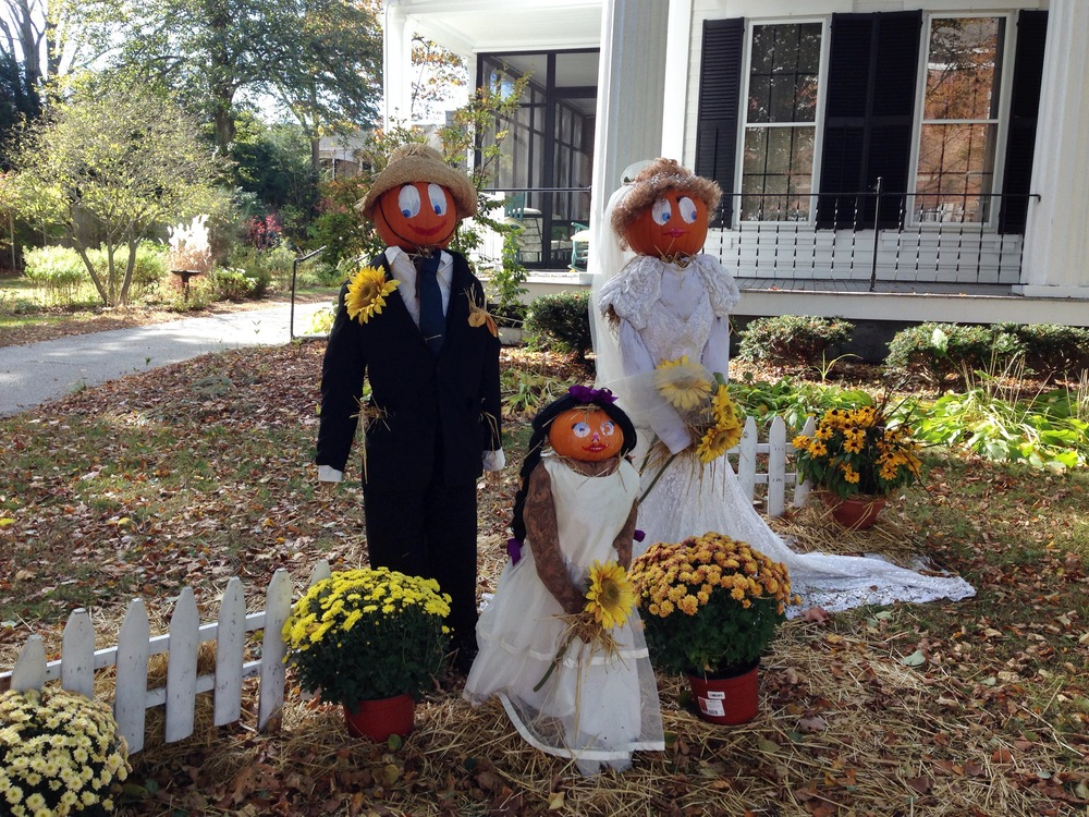 {Creepy but oddly cute Pumpkin head family in town}