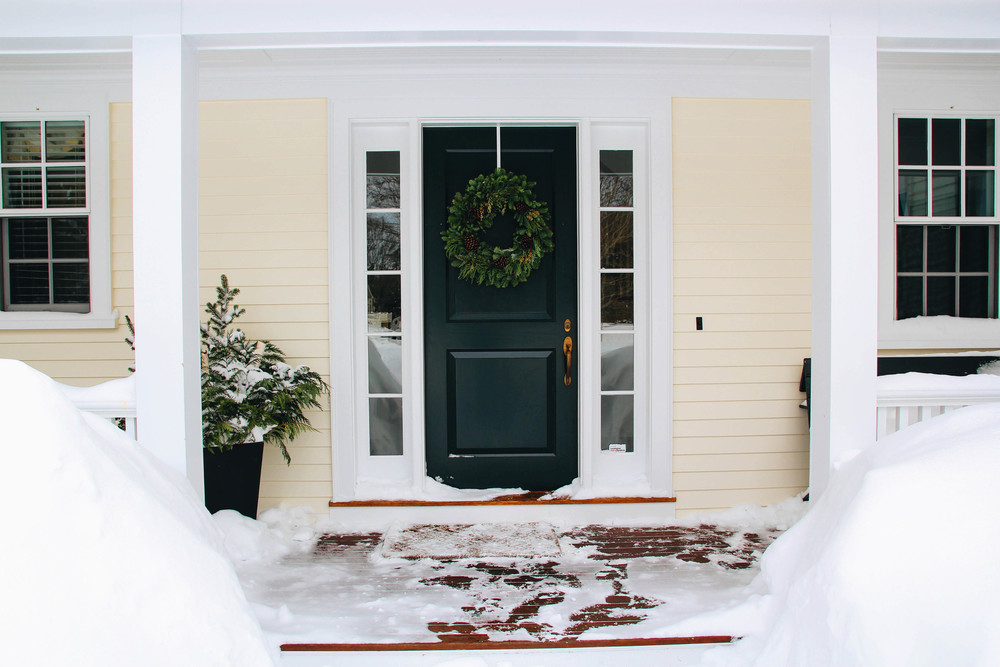 {Our disheveled, snow covered, front stoop}