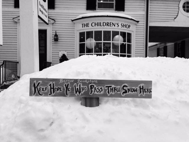 {A funny sign in the snow for the Barrow Bookstore}