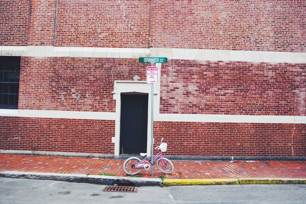 {A lonely pink bike on Beacon Hill}