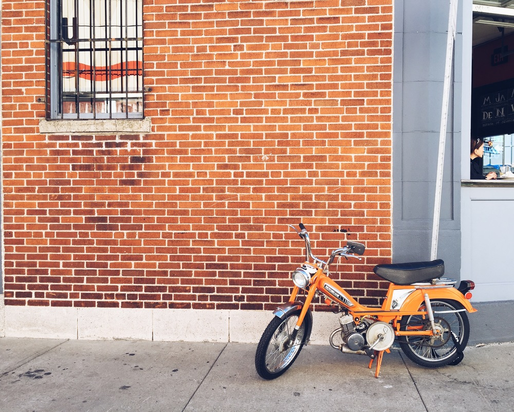 {Spotted this cute orange bike while walking to lunch}