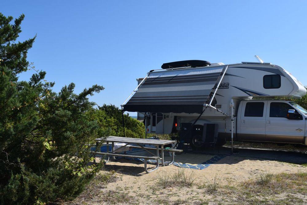 See the little ocean peek behind the camper?