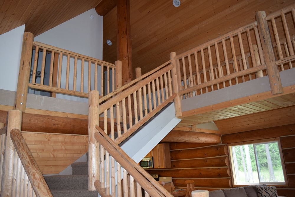 Up the stairs, the master is to the left, and the guest room is across the catwalk to the right. Both lofted. We might add a door to the master at some point.
