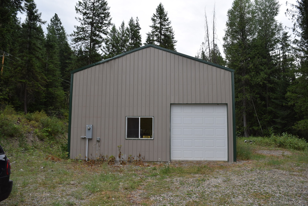 Did I mention the outbuilding? It's up by the road, about 300 steps from the house. It's 30x60 feet. That's 1800 square feet! Larger than any house we've lived in. Paul is raising the garage door so we can drive the camper in there.