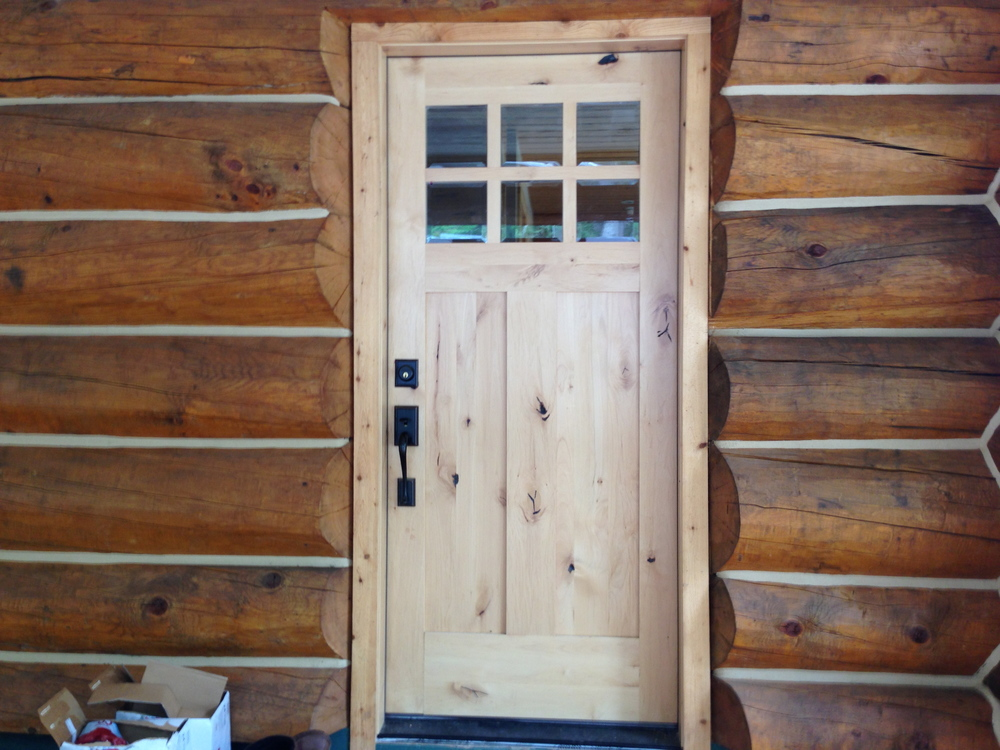 I love the front door. The glass makes it easier to look out before I go out to check for bears.