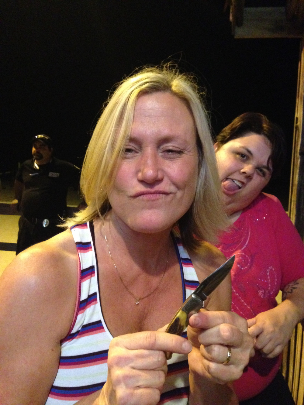 Trying for sexy face with Greg's knife, and I got photo bombed by Noelle, and apparently, a security guard. Drunk girl with a knife!
