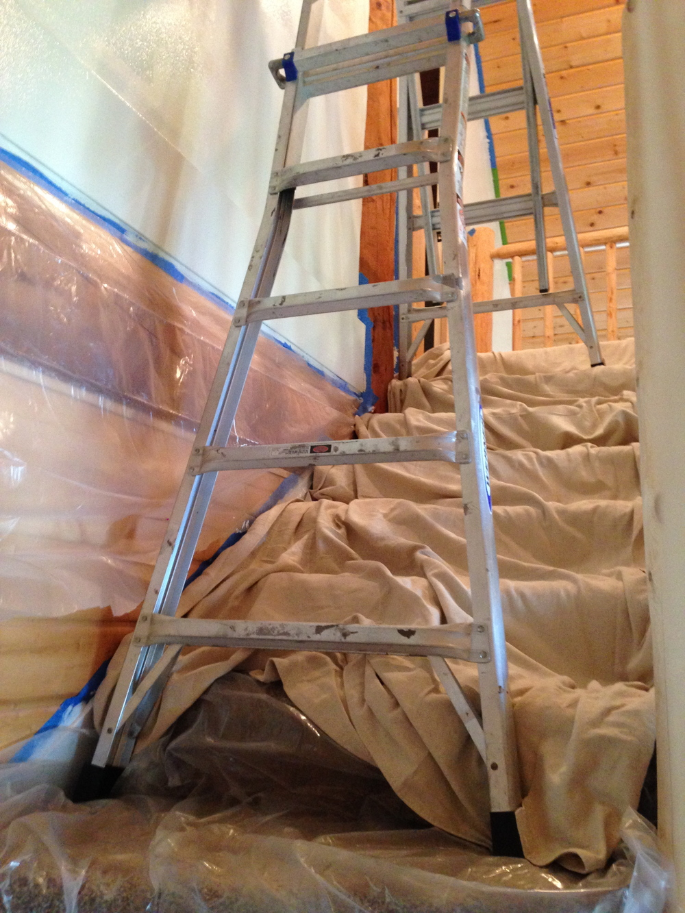This ladder is made for stairs, still looks sketchy! Painting the new wall.