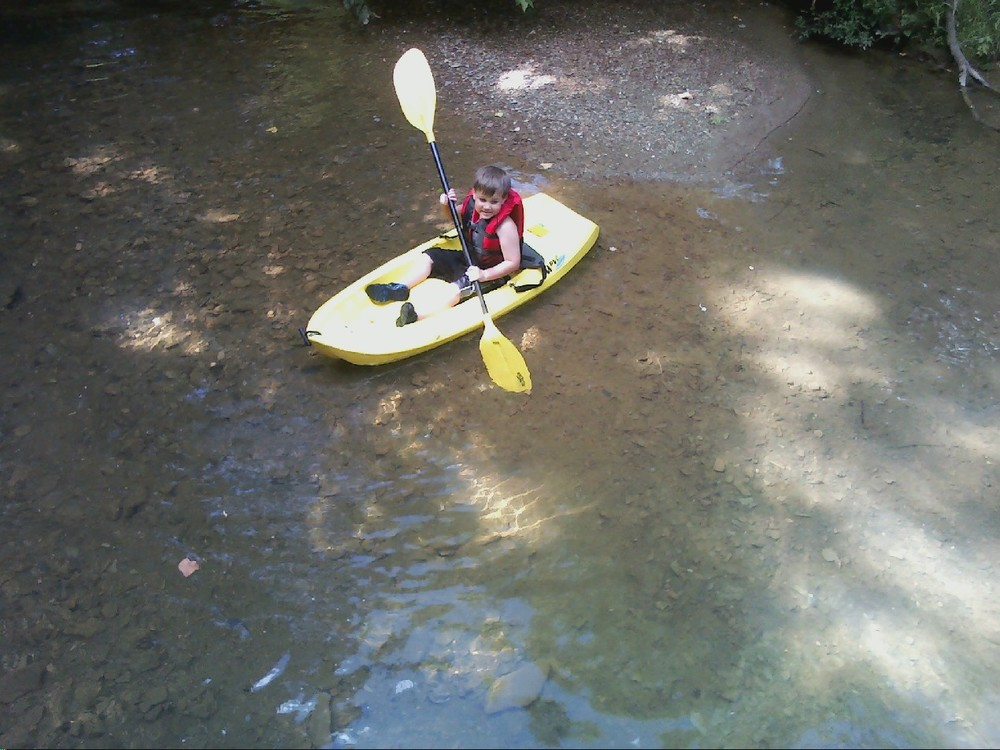 Ben, checking out the creek in his kayak.