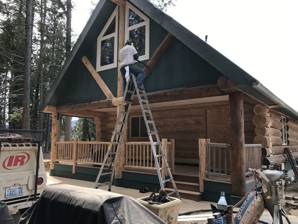 They are making progress on the cabin. Notice the old stain being removed?