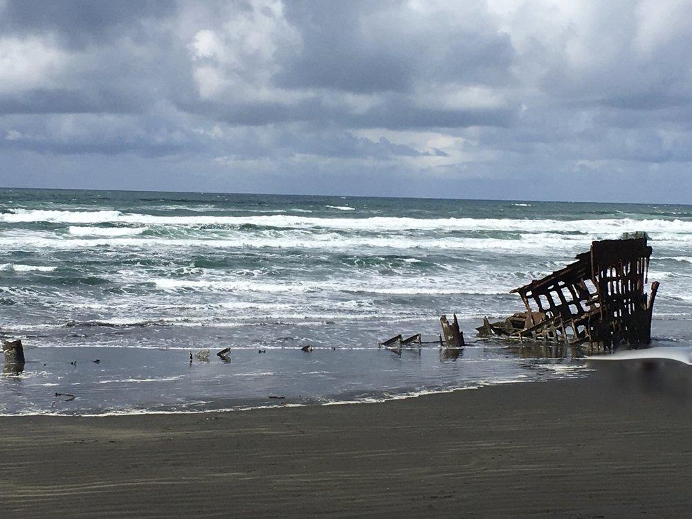 The shipwreck, hence the name Shipwreck Beach.