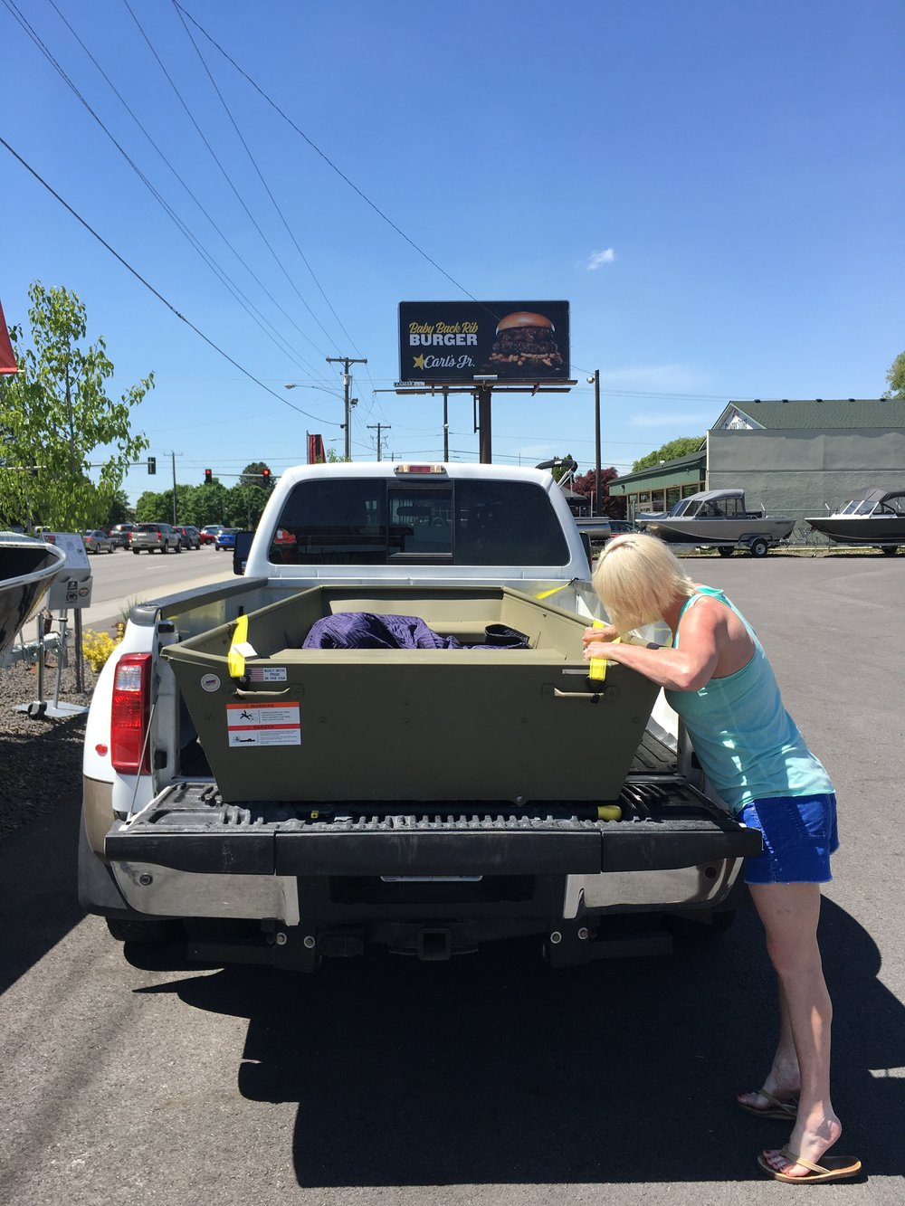 Bonus, it fits in the back of the truck! No trailer needed!