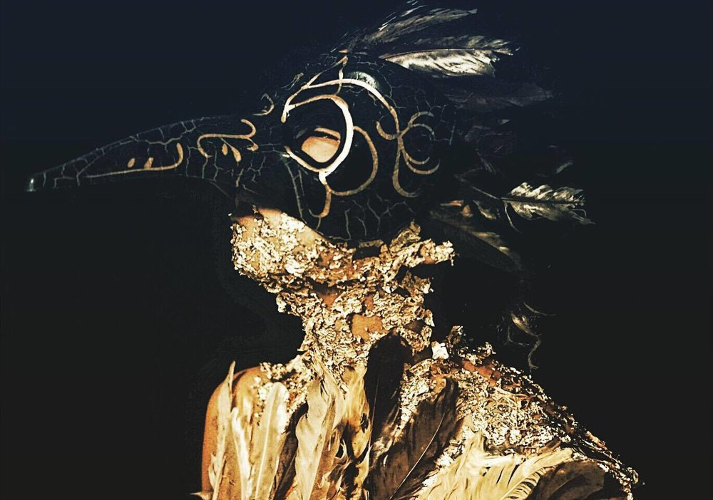 "An experimental series of gold continued: What once protected us, now kills us\ The history of the Venetian carnival raven mask is rooted in the 14th century when the plague ravaged Europe. The earliest historical textual evidence comes from Chief physician to Louis XIII, Charles de Lorme who created the mask as part of a 17th century Biohazard suit. He believed the mask he created would work as a filtration device that would prevent infection. Today, the plague mask lives on in the imaginations of artists, writers and film-makers. Through them, it has veeb transformed into something altogether different, for the plague mask which was once used to ward off death, has now become the very symbol of it. // I've been thinking a lot about gold lately. About currency. About money and how much man is moved by it. How much it boils down to sacrifice and sweat and bleeding knuckles. How many hours man will go to provide for family, how providing equates to how much you earn. How this gold once protected us. Gave a shelter, food and pockets that shimmer. But when does greed sprout the thorn that pricks the blistered hands? Capitalism a plague of ""never enough"" and man sick off his own Midas touch."