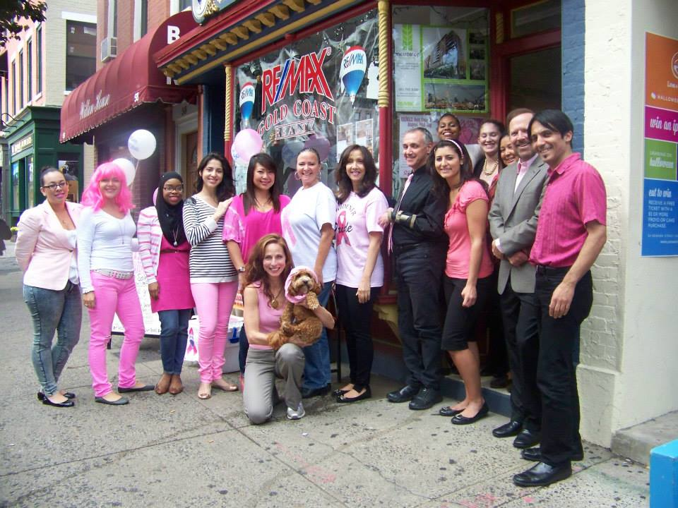 The team at RE/MAX Gold Coast Realty in Hoboken, NJ, works with 10 different charitable organizations. Here, the team poses before their latest Susan G. Komen for the Cure event.