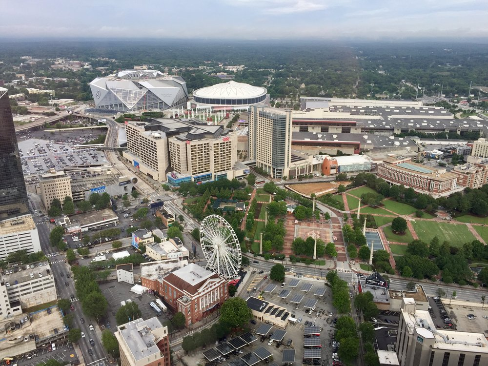 Bird's eye view of Atlanta, including Centennial Olympic Park, the Georgia Dome, the new Mercedes-Benz Stadium, and of course, the Georgia World Congress Center.