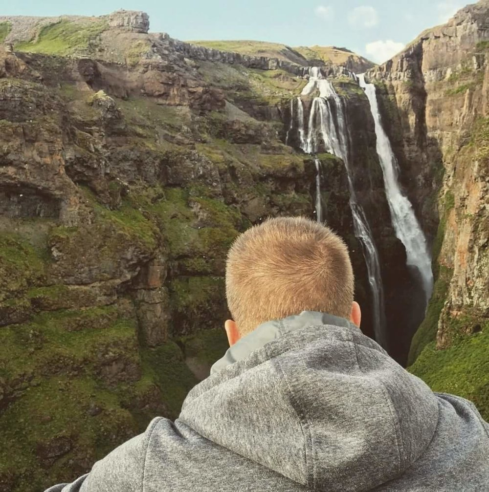 Leon at a waterfall in Iceland.