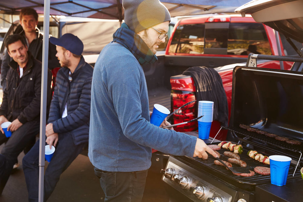 person tailgating grilling - resident event ideas